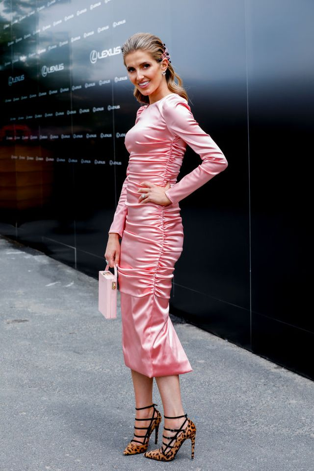 "<p>Kate Waterhouse wearing a<a href=""https://www.net-a-porter.com/au/en/product/1083955/Dolce_and_Gabbana/ruched-satin-midi-dress-"" target=""_blank"">Dolce & Gabbana</a> dress, a bag from <a..."