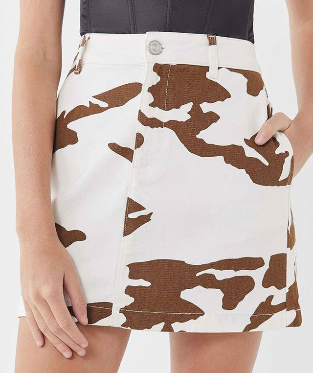 UO Rosie Cow Print Pelmet Mini Skirt