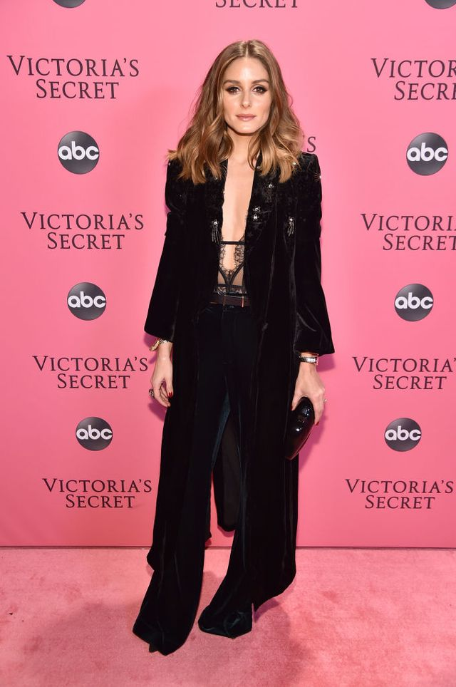 <p>Olivia Palermo wearing a black velvet suit and a patent black clutch.</p>