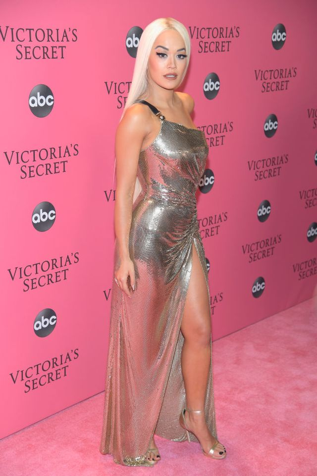 <p>Performer Rita Ora wearing a silver sequined gown and silver heels.</p>
