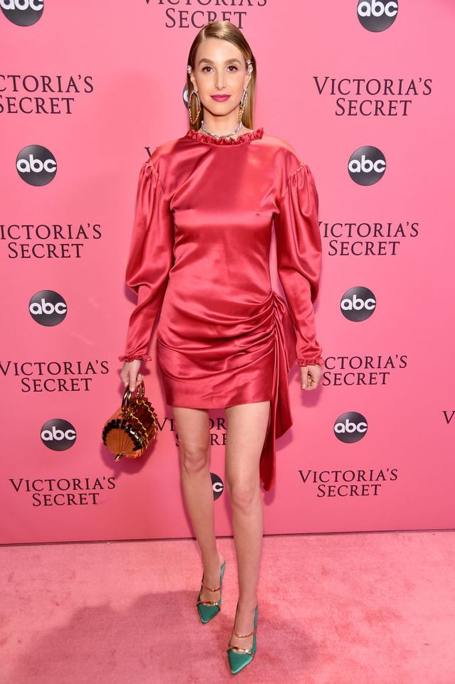 <p>Whitney Port wearing a satin mini dress, turquoise pumps and a Cult Gaia mini bag.</p>