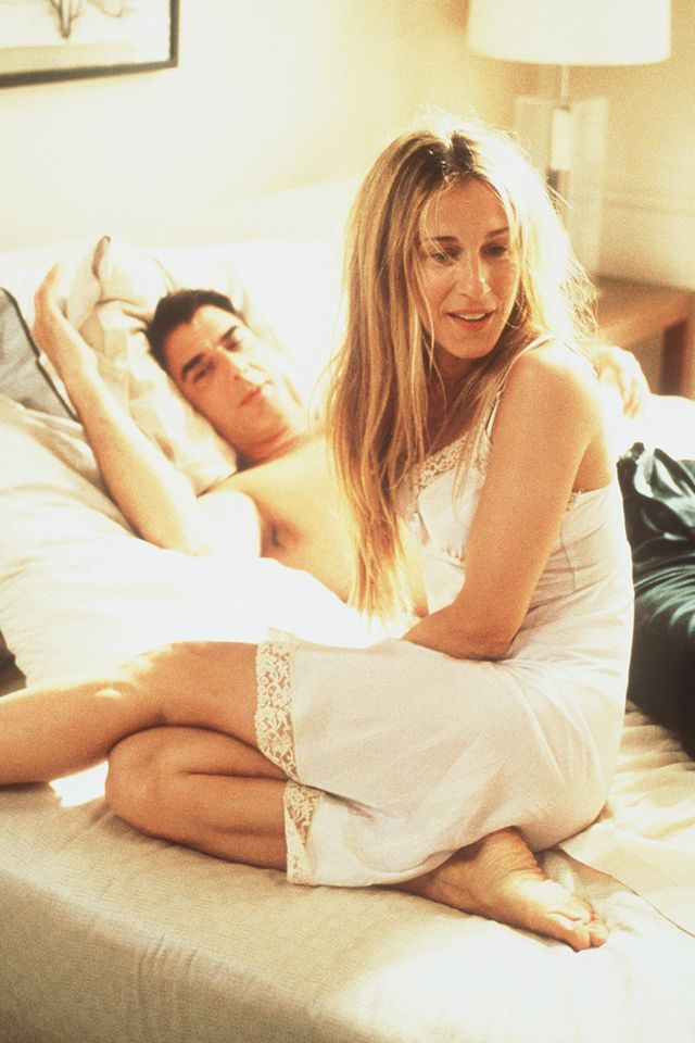<p>Slip dresses are now a staple item women are wearing in and outside of the bedroom. While in this exact shot, Carrie is lounging with Mr. Big, we wouldn't put it past her to rock the dress style...