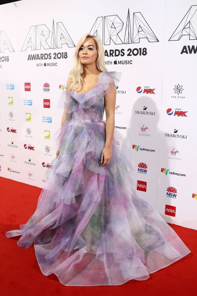 <p><strong>WHO</strong>: Rita Ora.</p> <p><strong>WEAR</strong>: A purple tulle gown with Tiffany & Co <a...