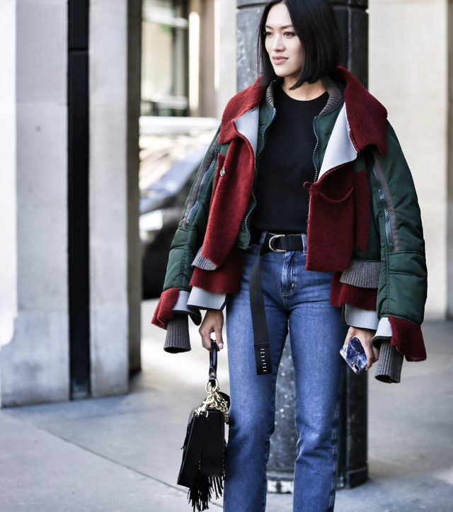 Layered jackets and bootcut jeans outfit