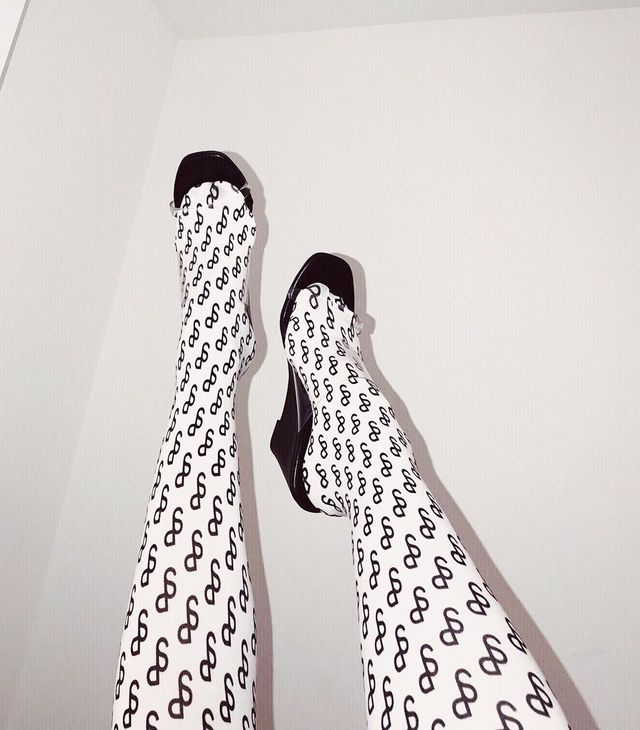 Saks Potts Tights: Style Memos picks up on the black print with her monochromatic heels.