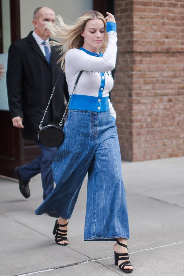 Margot Robbie in wide-leg jeans