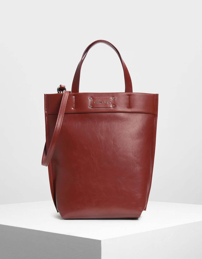 ac55a30a61 Red bags are our favorite styling trick to elevate a neutral outfit.  Pinterest