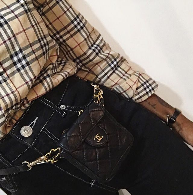 Burberry vintage check: a plaid shirt worn with black jeans and a Chanel bag