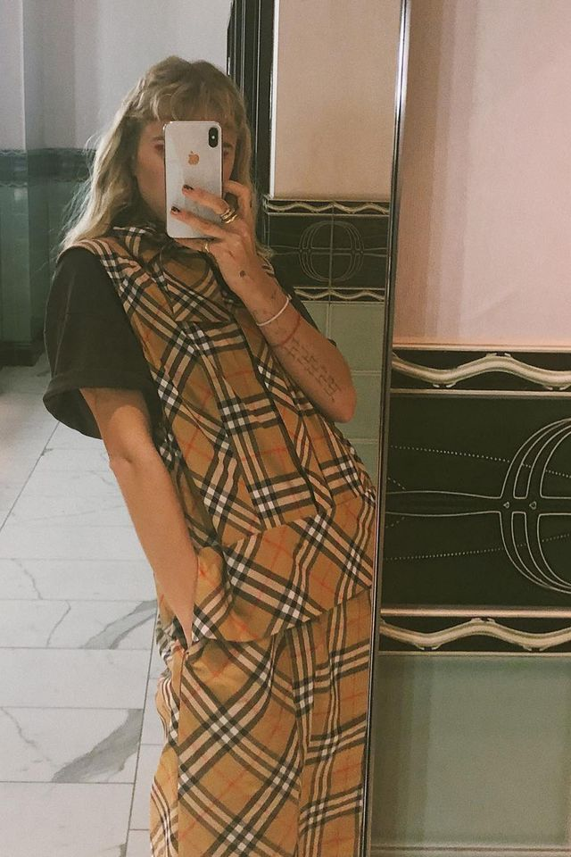 Burberry vintage check: a plaid dress layered over a T-shirt