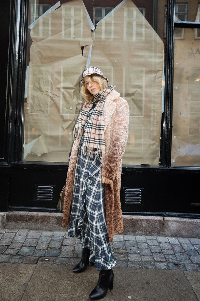 Burberry vintage check: a plaid bucket hat and matching scarf worn with a faux fur coat