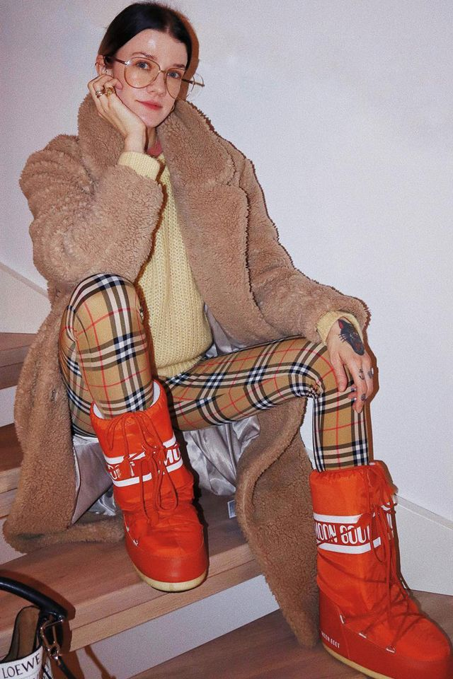 Burberry vintage check: plaid leggings worn with a shearling coat and moon boots