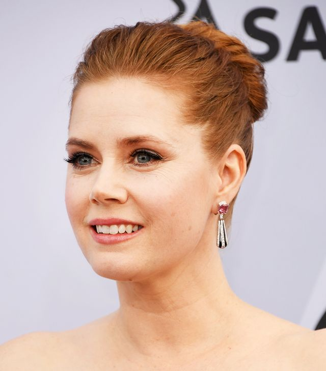 <p>We always anxiously Amy Adams' red carpet arrival. Here, she keeps the focus on her face (fluttery lashes and a flash of liner) with her romanticupdo.</p>