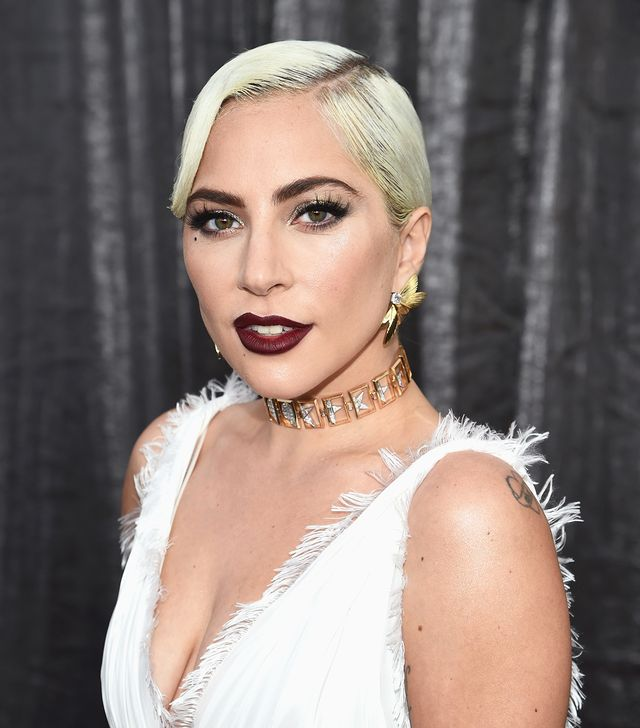 <p>Lady Gaga adorns her metallic-set eyelids with eye-brow grazing lashes, slicked platinum strands, and the most delicious of wine-stained lips. </p>