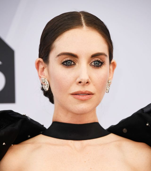 <p>Almost gothic in inspiration, Alison Brie's stark center part is a bold accent to her ink-rimmed eyes, long lashes, and a perfectly chosen peachy-nude pout. </p>