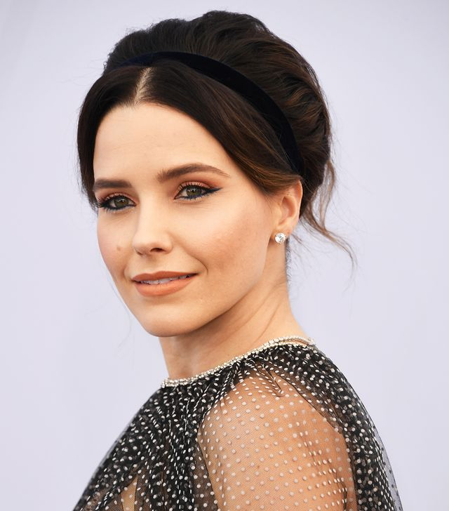 <p>Sophia Bush typically wears her hair down or slicked back in a pin-tight bun or pony, so this pillowy updo (secured with a super-chic velvet headband, no less), is making our world go round....