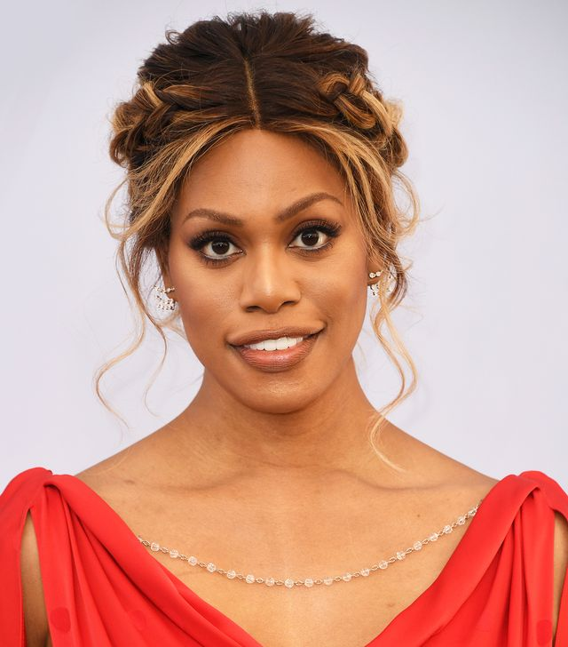 <p>To accent the gorgeous and romantic draping of her dress, actress Laverne Cox kept her honey-hued highlights swept off her shoulders in braids and curls for a classic hair moment. </p>