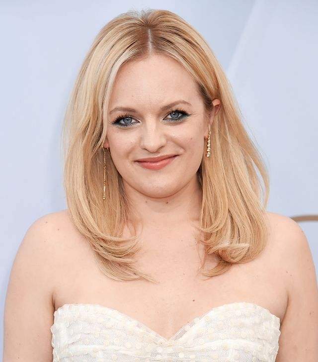 <p>We don't see Elisabeth Moss take huge beauty risks, but we're giving the actress major snaps for this teal liner look that offsets her buttery blond hair color with well-played drama. </p>