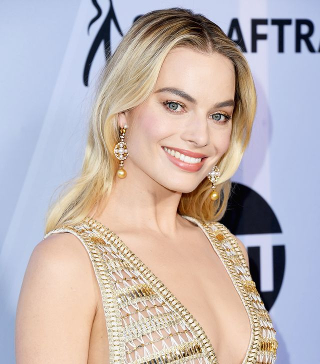 <p>Ahhh, Margot Robbie. When it comes to flawless skin that looks like it's been touched by an angel, (oh, and always a shimmering lid), the actress just can't be beaten. </p>