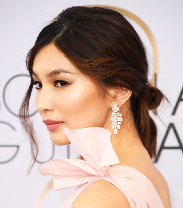 <p>We're not sure what we're more obsessed with—Gemma Chan's perfect contour and highlight (is she even human?!) or her pretty swept back bun. </p>