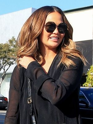 Chrissy Teigen Wore a $15K Gucci Bag With Ripped Skinny Jeans in Beverly Hills