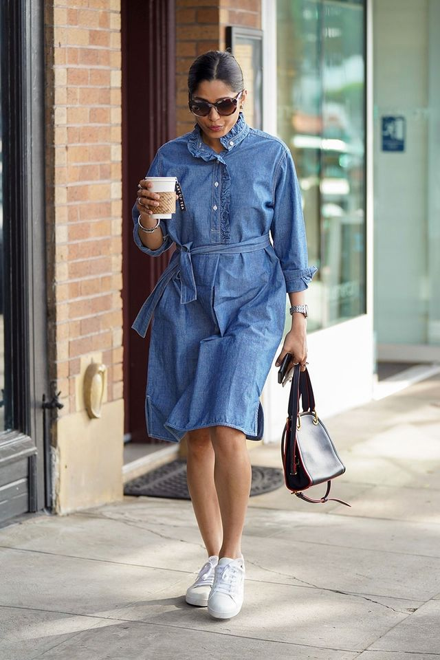 Freida Pinto denim dress and sneakers