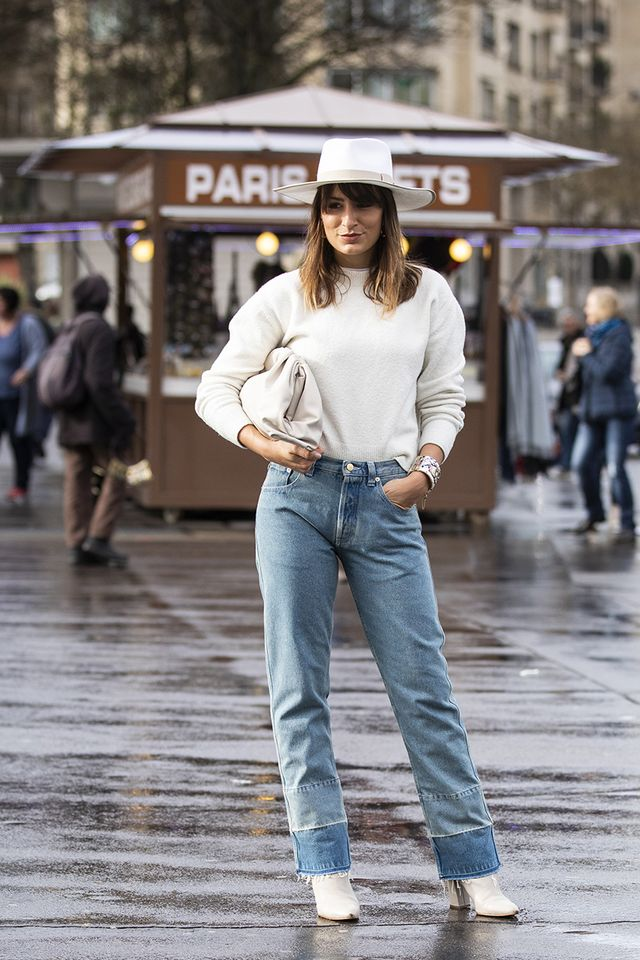 Light-wash jeans and white boots
