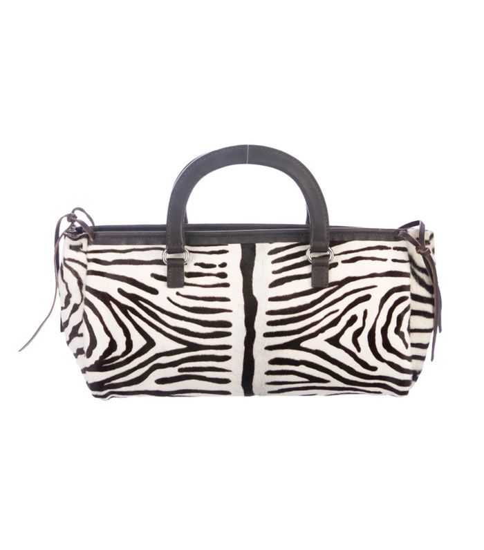 b35e44ae38a1 Pinterest · Shop · Prada Ponyhair Printed Top Handle Bag ($295). This purse  is everything I've ever wanted.