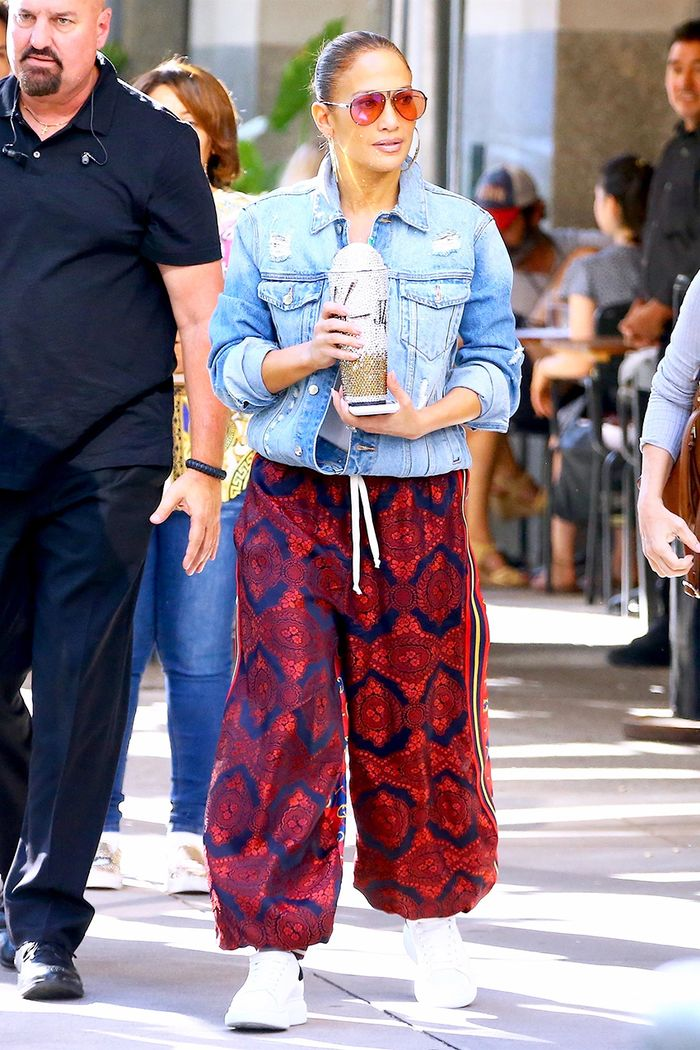 Jennifer Lopez Wore a Denim Jacket and Sneakers With $2K Gucci Pants