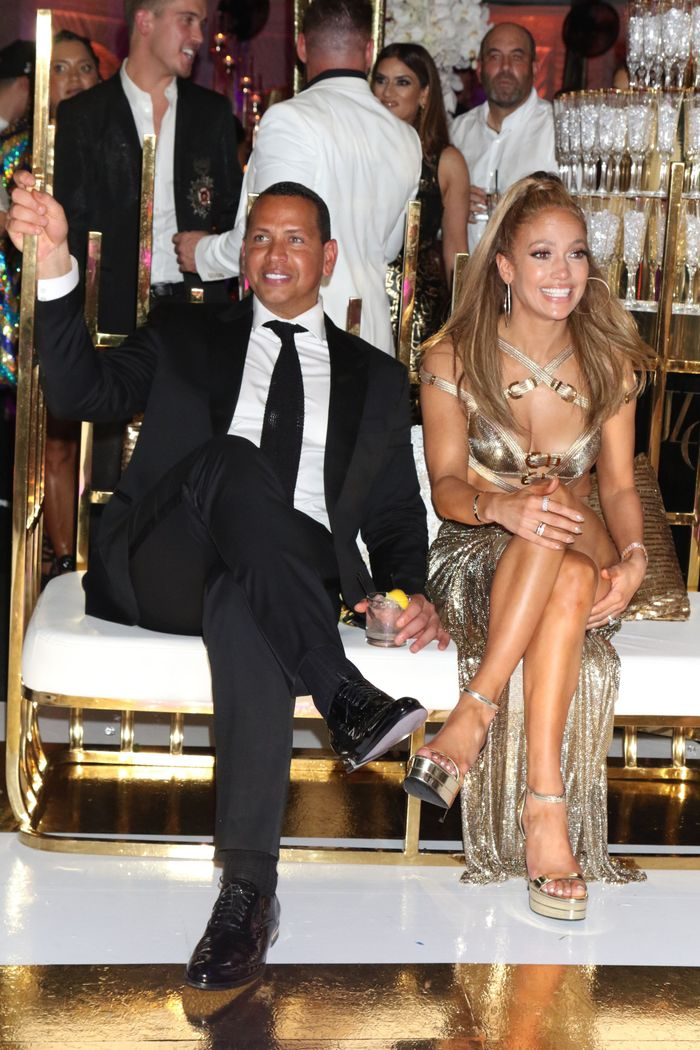 J.Lo Wore a Bondage-Inspired Dress With a Hip-High Slit for Her 50th B-day Party