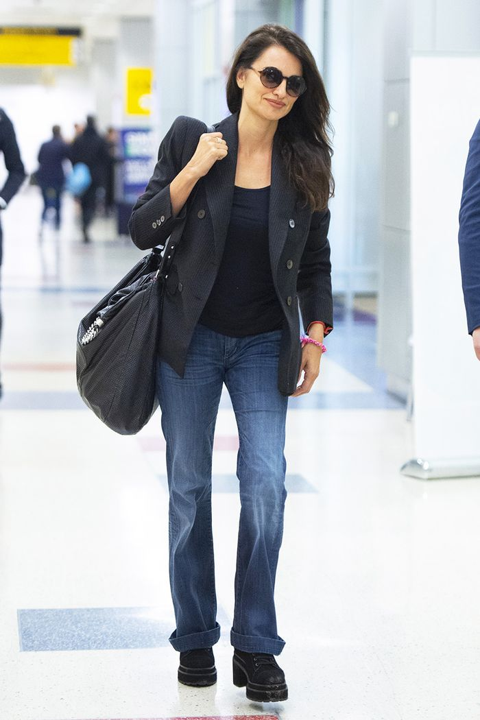 Penelope Cruz Wore the Denim Trend That's Rivaling Skinny Jeans to the Airport