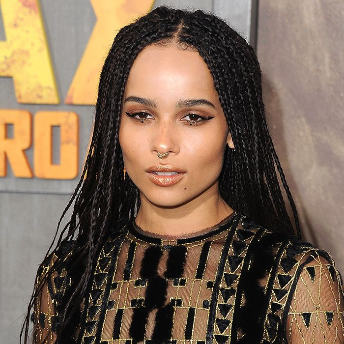 Woman With Boho Box Braids That Have Hair Rings In Them