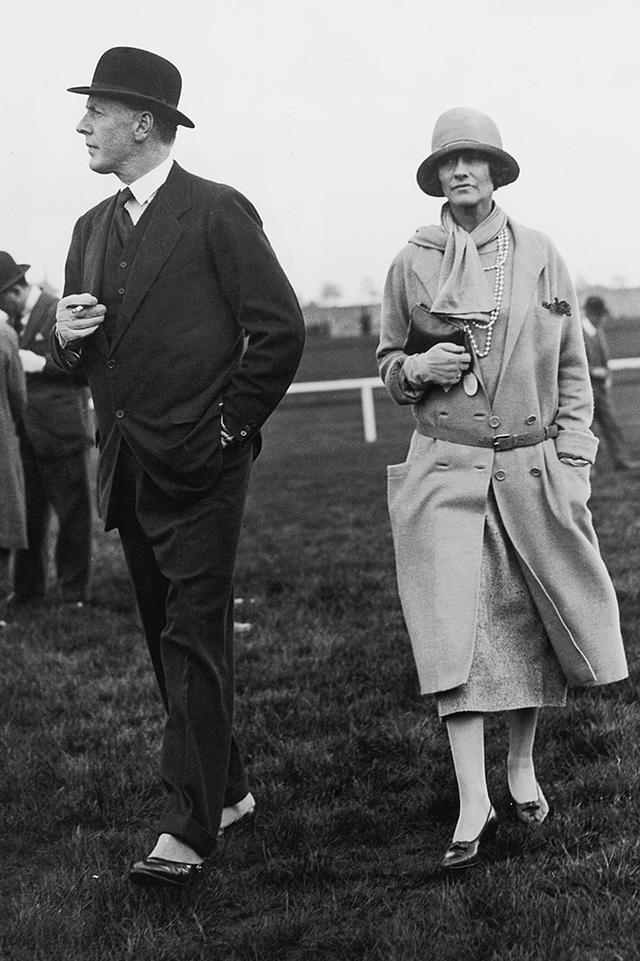 <p><em>Coco Chanel with Hugh Grosvenor, 2nd Duke of Westminster,at Chester Races, 1924</em></p>