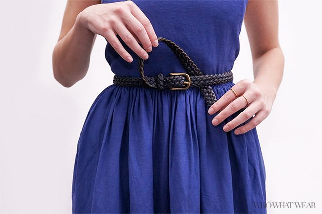 Step 3. Take the tail end, loop it across the belt buckle, and tuck it behind the belt.