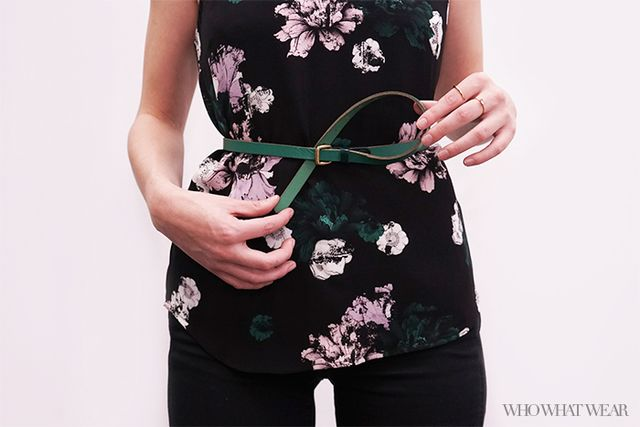 Step 4: Slip it underneath the belt, just to the left of your buckle.