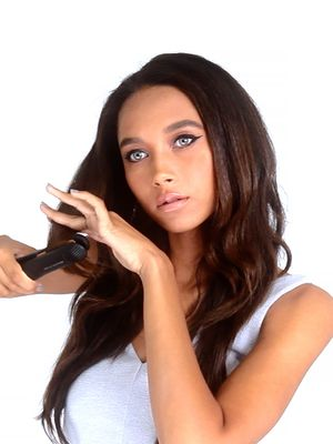Video Tutorial: How to Wave Your Hair With a Straightener