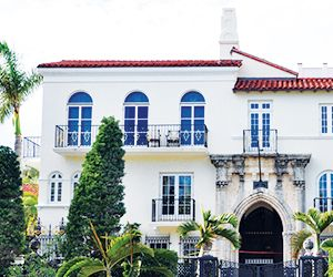 Click Addiction: Posh + Becks Eye a Versace Mansion Buy