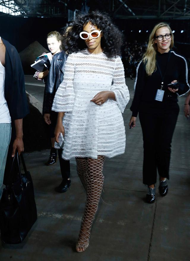 WHO: Solange Knowles  WHAT: 3.1 Phillip Lim S/S 16 show  WEAR: Zimmermann dress; Schutz Karlyanna Caged Knee-High Heels ($395).