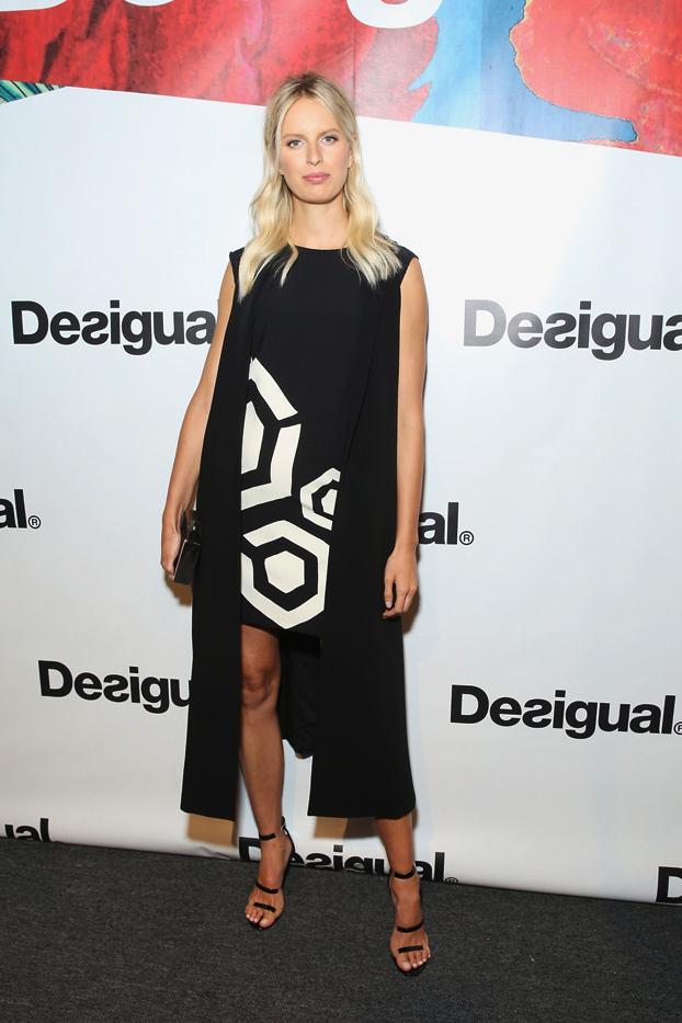 WHO: Karolina Kurkova  WHAT: Desigual S/S 16 show  WEAR:Elizabeth and James vest; Desigual Asha Dress ($140); Tamara Mellon Frontline Specchio Sandals ($595).