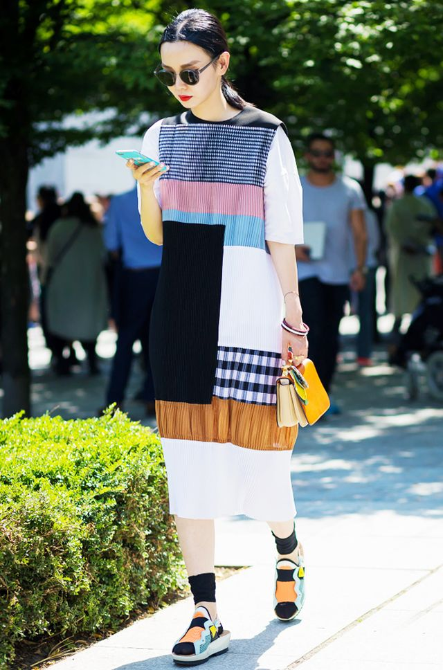 Street style star Sherry Shen made a huge statement with her patchwork dress and bright accessories.