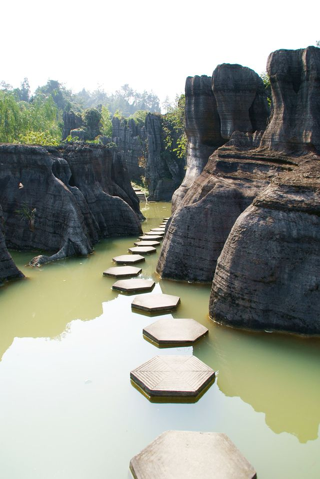 Formed some 600 million years ago, the Wansheng Stone Forest, pictured here, seems like the entrance to a fairy-tale land.