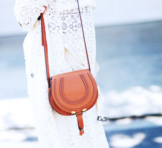Another case in point for colour contrast, white lace will lend a feminine edge to the tan Chloé Marcie bag and help it stand out.