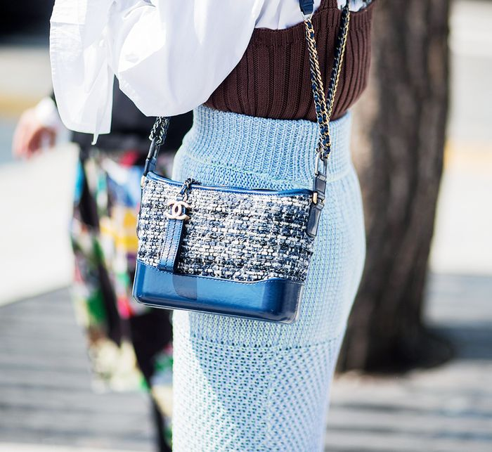 Classic Chanel bags: a street style girl wearing Chanel's Gabrielle bag