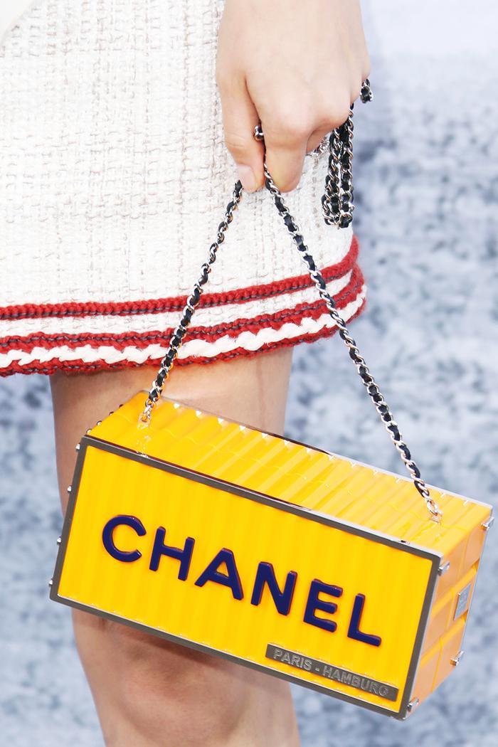 Chanel bags: Suki Waterhouse carrying a yellow logo minaudiere