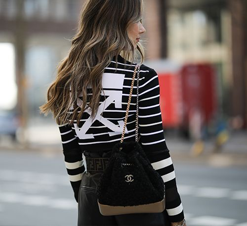 Classic Chanel bags: blogger carrying a Chanel backpack