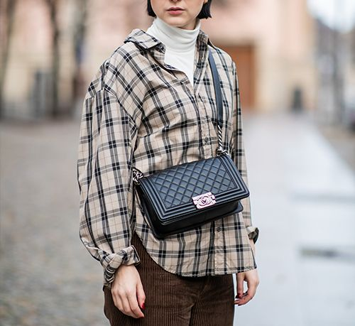 Chanel bags: a street style girl carrying a red Chanel Boy bag