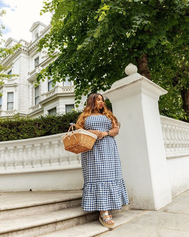 How to wear gingham: Lauren-Nicole wears a gingham maxi dress whilst carrying a basket bag