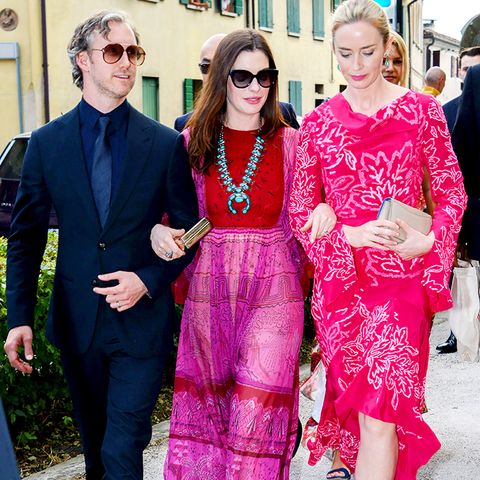 celebrity wedding guest outfits: anne hathaway and emily blunt