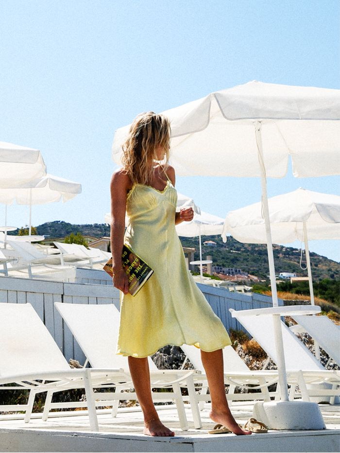 Beach outfit ideas: Lemon slip dress on Lucy Williams