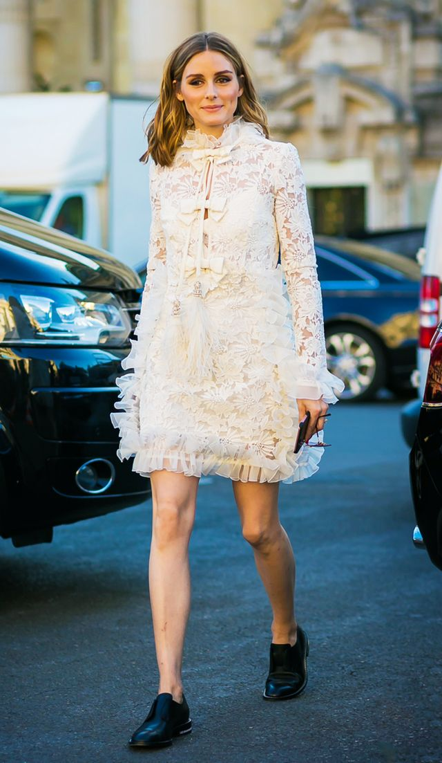 what to wear to an engagement party: olivia palermo white lace dress and flat shoes