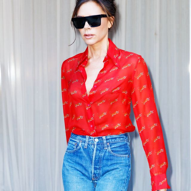 Victoria Beckham Style: VB wearing a red shirt and jeans